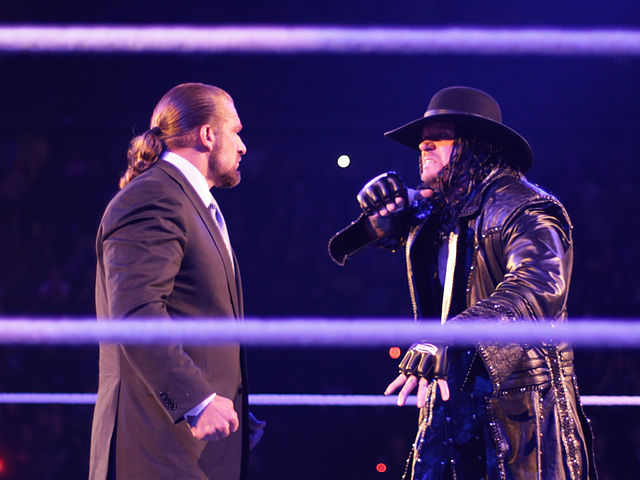 The Undertaker (right) staring down Triple H on the January 30, 2012 episode of WWE Raw. Photo By: Steve Wright Jr.