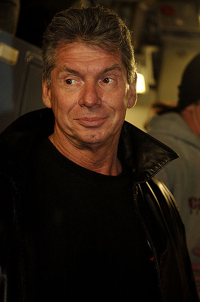 Vince McMahon, the Chairman of the Board of the World Wrestling Entertainment, Inc. boards a C-17 Globemaster III at Charleston Air Force Base, S.C. The 437th Aerial Port Squadron hosts the WWE stars and crew before a flight to Ramstein Air Base, Germany, Dec. 5, 2006. Photo By: Airman 1st Class Nicholas Pilch.
